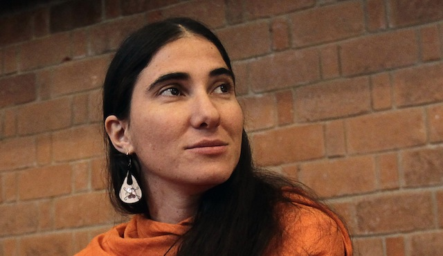 Cuba's best-known dissident blogger Yoani Sanchez listens to a question after she delivered a speech to students of the Iberoamericana University in Mexico City