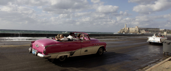 Tourists ride in classic cars along Havana's Malecon, Tuesday, April 7, 2009.