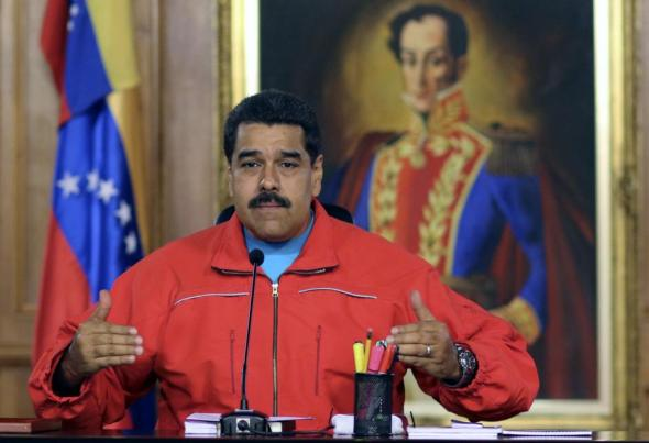 "Handout picture released by the Venezuelan presidency press office showing Venezuelan President Nicolas Maduro during a press conference after knowing the first result in the legislative election,  in Caracas on December 7, 2015. Venezuela's opposition won control of the state legislature, electoral authorities said Monday, in a blow to the oil-rich country's socialist government that has held the congress for 16 years. Maduro called for the opposition to ""live together"" with his side.   AFP PHOTO/PRESIDENCIA     RESTRICTED TO EDITORIAL USE - MANDATORY CREDIT ""AFP PHOTO / PRESIDENCIA"" - NO MARKETING NO ADVERTISING CAMPAIGNS - DISTRIBUTED AS A SERVICE TO CLIENTS"