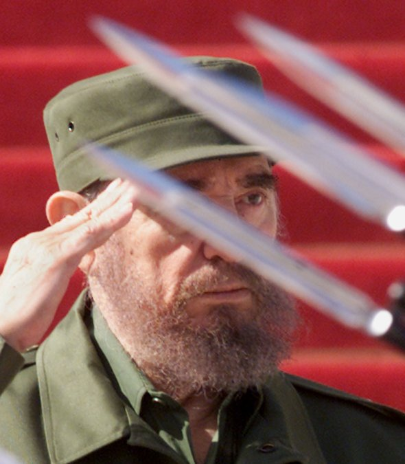 MILITARY BAYONETS PASS IN FRONT OF CUBAN PRESIDENT CASTRO IN HAVANA
