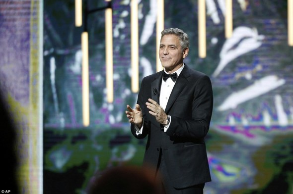 3da21bf900000578-4258448-clooney_said_in_his_speech_as_we_stand_here_today_the_world_is_g-a-16_1487994108726
